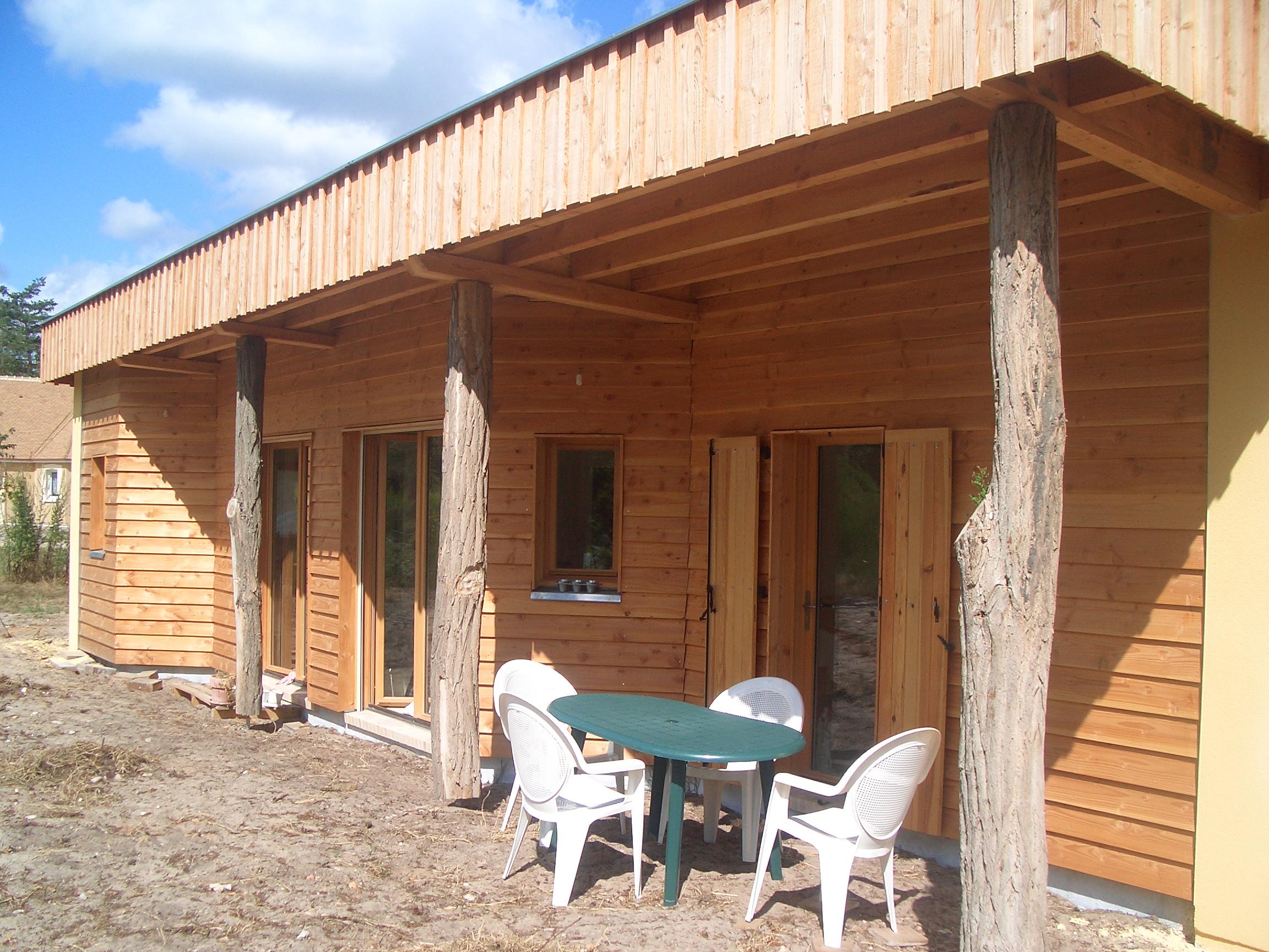 Les eco logis bois sarthe lombron construction for Agrandissement toit plat